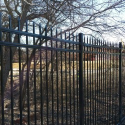 iron fencing installation with pointed tips