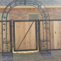 gate on wooden fencing for residence