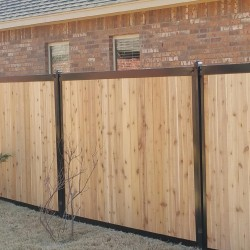 wooden privacy fencing with black accents