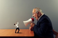 senior boss screaming at small businessman